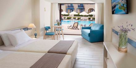 Bungalow med delad pool på hotell Aldemar Olympian Village i Skafidia, Grekland.