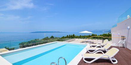 Tvårumslägenhet med delad pool på hotell Apollo Mondo Family Romana i Makarska, Kroatien.