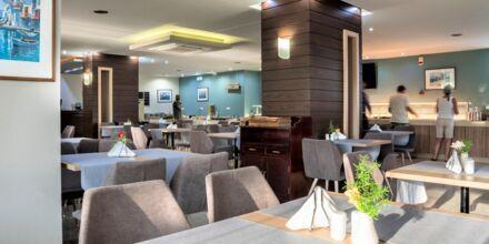 Restaurang på hotell Atrion i Agia Marina på Kreta, Grekland.