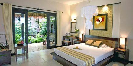 Deluxerum i bungalow på hotell Bamboo Village Resort i Phan Thiet, Vietnam.