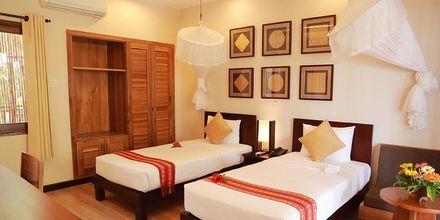 Deluxerum på hotell Bamboo Village Resort i Phan Thiet, Vietnam.
