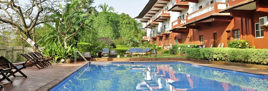 Poolområdet på hotell Chalston Beach Resort i Goa, Indien.