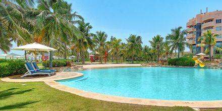 Poolområde på hotell Crowne Plaza Resort, Oman.