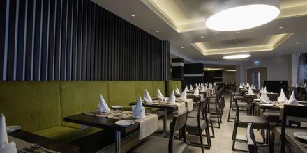 Restaurang på hotell Evalena Beach i Fig Tree Bay, Cypern.