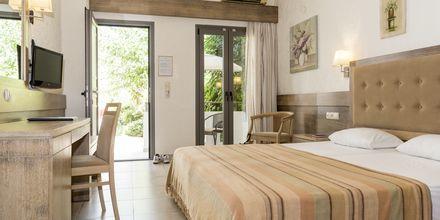 Renoverad enrumslägenhet på hotell Flamingos på Kreta, Grekland.