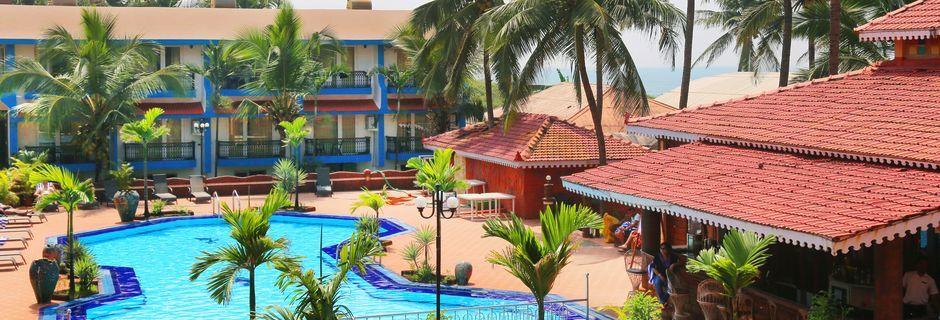 Poolområdet vid hotell Goan Heritage i Norra Goa, Indien.