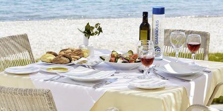 À la carte-restaurang på hotell Grand Bay Beach Resort på Kreta, Grekland.