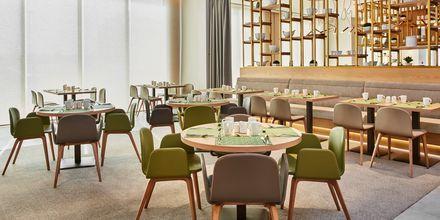 Restaurangen på hotell Hilton Garden Inn Mall of the Emirates i Dubai Al Barsha i Dubai, Förenade Arabemiraten.