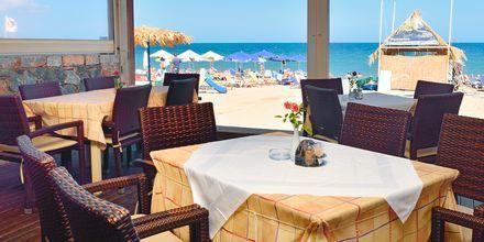 Strandrestaurangen på hotell Ideal Beach på Kreta, Grekland.