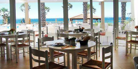 Frukostservering på hotell Irina Beach i Tigaki på Kos, Grekland.