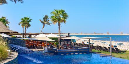 Poolområde på Hotell JA Beach i Dubai.