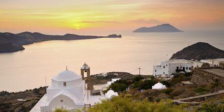 Solnedgång över Milos i Grekland.