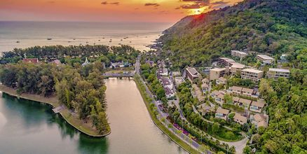 Apollos hotell Sunsuri Phuket i Nai Harn Beach.