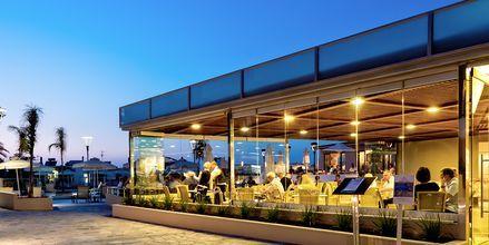 Restaurang på hotell Porto Platanias Village på Kreta.