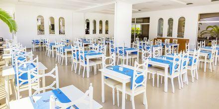 Restaurang på hotell Rethymno Residence vid Rethymnon kust på Kreta, Grekland.