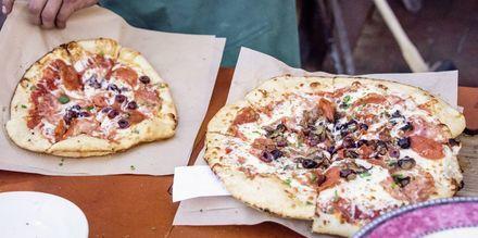 Njut av åtminstone en eller två italienska pizzor i Rom!