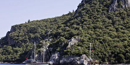 Upptäck den antika staden Olympus som tidigare var ett populärt tillhåll för pirater.