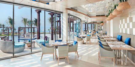 Restaurang Palm Avenue på hotell Waldorf Astoria Dubai Palm Jumeirah i Dubai, där mat med influenser från Europa serveras.