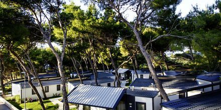 Trerumslägenhet i bungalow på Waterman Beach Village Bungalow.