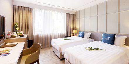 Deluxerum på hotell Well i Bangkok, Thailand.